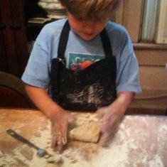 Logan making pasta age 4