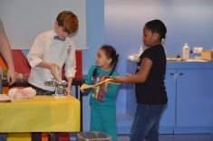Logan teaching youths how to make pasta